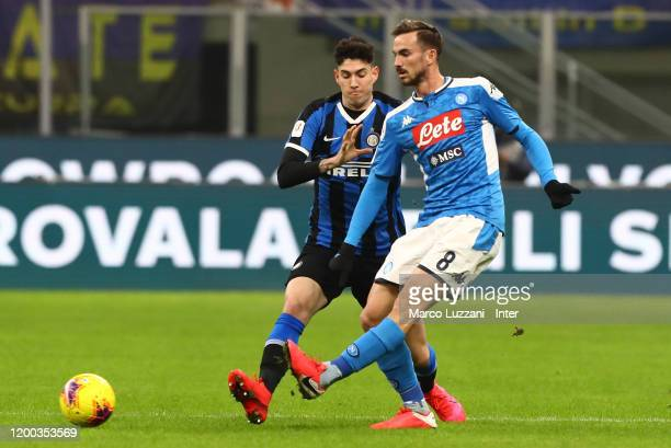 Alessandro Bastoni of FC Internazionale competes for the ball with Fabian Ruiz of SSC Napoli during the Coppa Italia Semi Final match between FC...