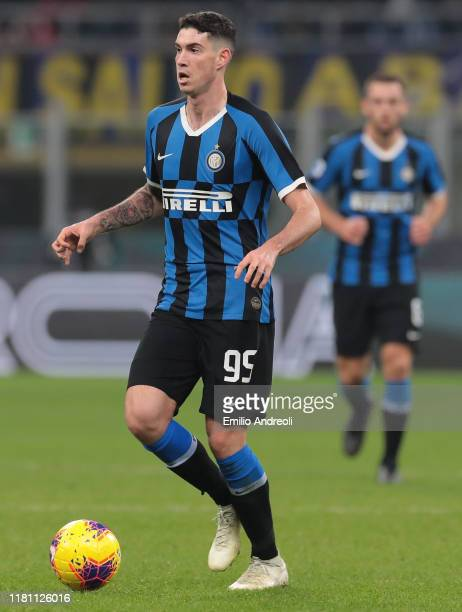 Alessandro Bastoni of FC Internazionale in action during the Serie A match between FC Internazionale and Hellas Verona at Stadio Giuseppe Meazza on...