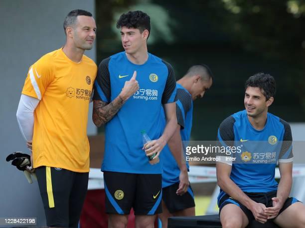 Alessandro Bastoni of FC Internazionale speaks with his teammate Samir Handanovic during the FC Internazionale training session at the club's...