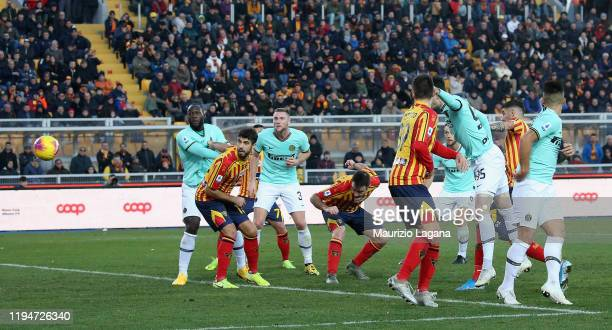 Alessandro Bastoni of Inter scores his team's opening goal during the Serie A match between US Lecce and FC Internazionale at Stadio Via del Mare on...
