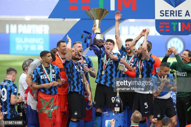 Alessandro Bastoni of Internazionale celebrates with the Scudetto trophy during the presentation following the Serie A match between FC...