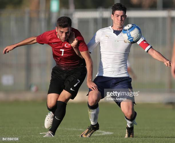 Alessandro Bastoni of Italy competes for the ball with Karakas Ilker of Turkey during the U19 international friendly match between Italy U19 and...
