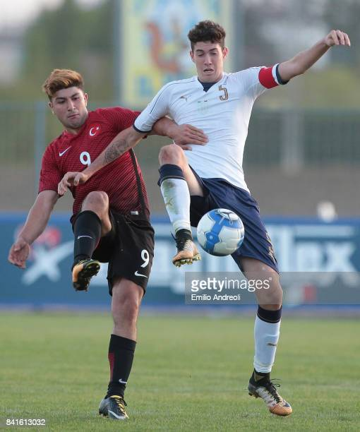 Alessandro Bastoni of Italy competes for the ball with Yalcin Guven of Turkey during the U19 international friendly match between Italy U19 and...