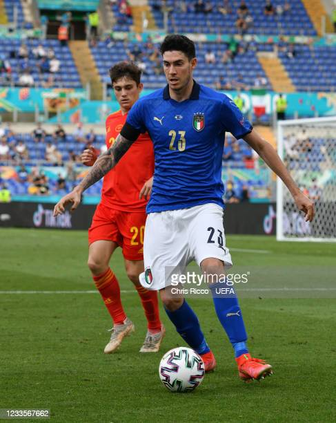 Alessandro Bastoni of Italy evades a challenge from Daniel James of Wales during the UEFA Euro 2020 Championship Group A match between Italy and...