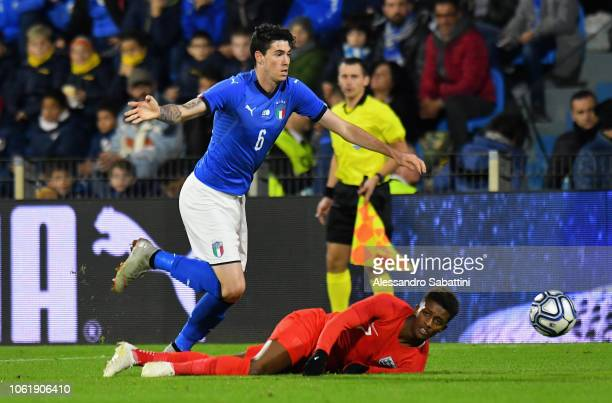 Alessandro Bastoni of Italy U21 competes for the ball with Demarai Gray of England u21 during the International friendly match between Italy U21 and...