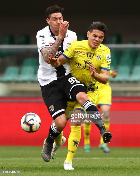 Alessandro Bastoni of Parma Calcio clashes with Mariusz Stepinski of Chievo Verona during the Serie A match between Chievo Verona and Parma Calcio at...