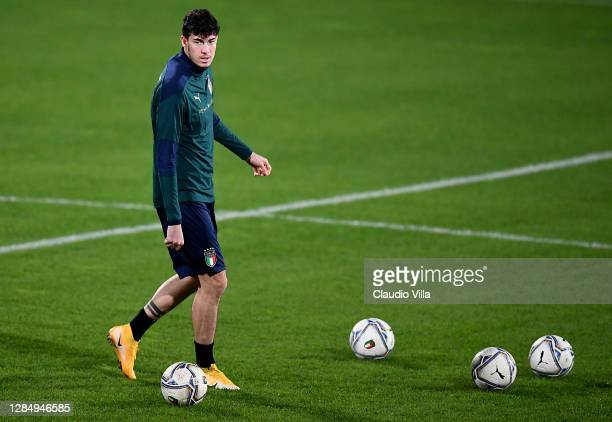 Alessandro Bastoni walks on the pitch during an Italy Training Session at Centro Tecnico Federale di Coverciano on November 10, 2020 in Florence,...