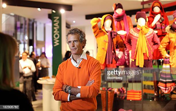 Alessandro Benetton chairman of Benetton Group SpA speaks during a television interview during the launch of the company's Unemployee of the Year...