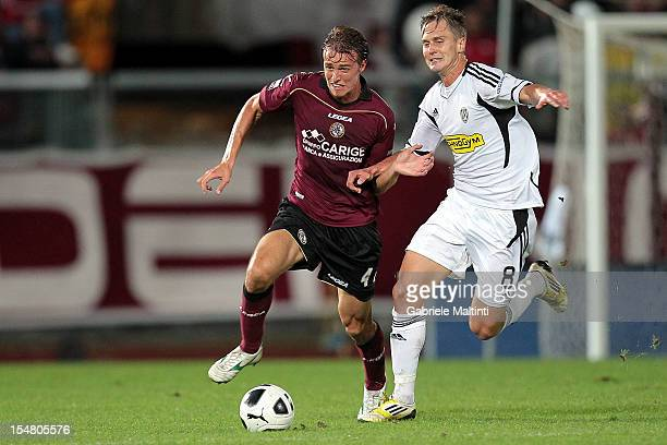 Alessandro Bernardini of AC Livorno fights for the ball with Damjan Djokovic of AC Cesena during the Serie B match between AS Livorno and AC Cesena...