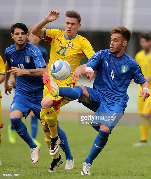 Alessandro Bordin of Italy competes for the ball with Tiberiu Capusa of Romania during the U18 international friendly match between Italy and Romania...