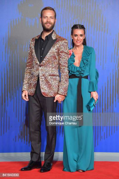 Alessandro Borghi and Roberta Pitrone walk the red carpet ahead of the 'Suburra La Serie' screening during the 74th Venice Film Festival at Sala...