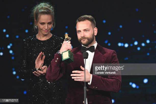 Alessandro Borghi receives the Best Main Actor award from Uma Thurman during the 64 David Di Donatello Award Ceremony on March 27 2019 in Rome Italy