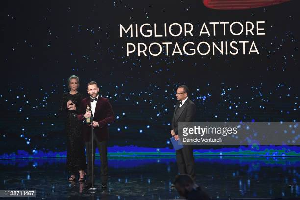 Alessandro Borghi receives the Main Actor award from Uma Thurman and Carlo Conti during the 64 David Di Donatello Award Ceremony on March 27 2019 in...