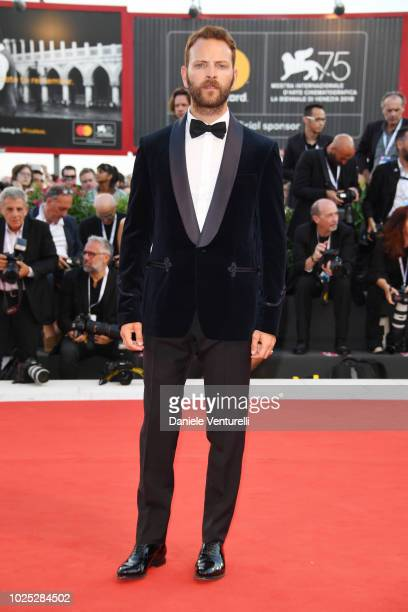 Alessandro Borghi walks the red carpet ahead of the 'Roma' screening during the 75th Venice Film Festival at Sala Grande on August 30 2018 in Venice...
