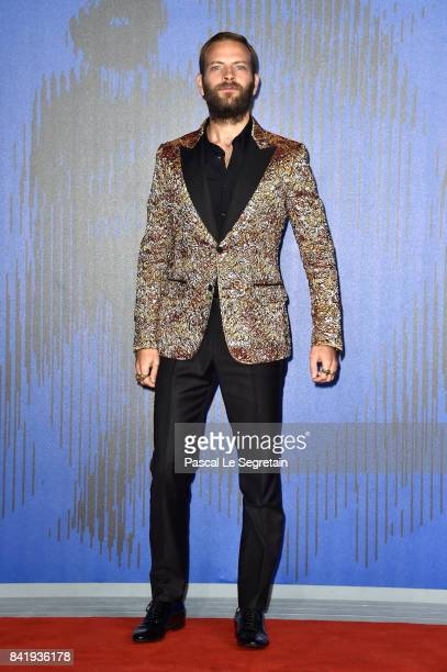 Alessandro Borghi walks the red carpet ahead of the 'Suburra La Serie' screening during the 74th Venice Film Festival at Sala Giardino on September 2...