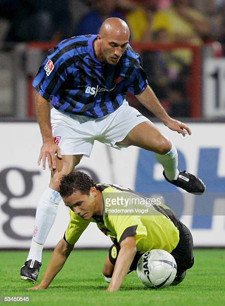 Alessandro Caruso of Braunschweig challenges for the ball with Philipp Degen of Dortmund during the DFB German Cup match between Eintracht...