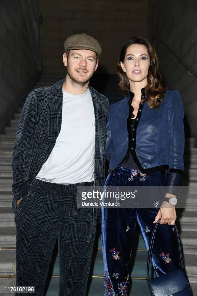 Alessandro Cattelan and Ludovica Sauer attend the Giorgio Armani fashion show during the Milan Fashion Week Spring/Summer 2020 on September 21, 2019...