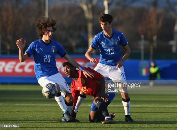 Alessandro Cortinovis of Italy and Cedric Wilfred of Spain compete for the ball during the U17 International Friendly match between Italy and Spain...