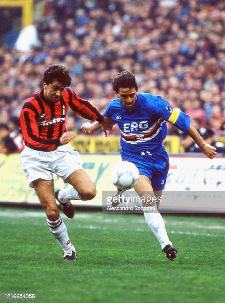 Alessandro Costacurta of AC Milan competes for the ball with Roberto Mancini of Sampdoria during the Seria A match between AC MIlan and Sampdoria...