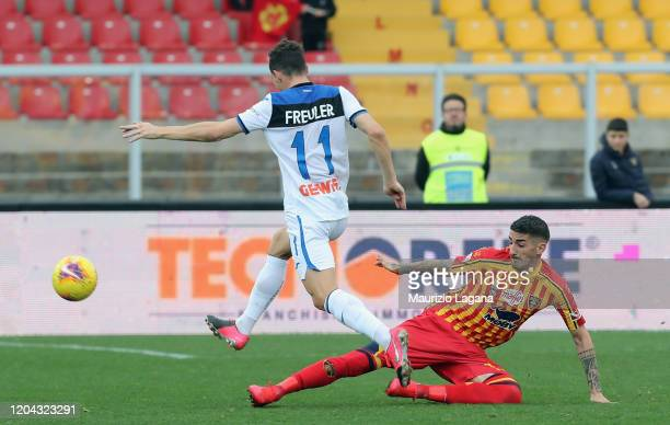 Alessandro Deiola of Lecce competes for the ball with Remo Freuler of Atalanta during the Serie A match between US Lecce and Atalanta BC at Stadio...