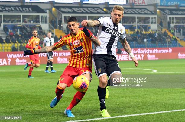 Alessandro Deiola of US Lecce competes for the ball with Juraj Kucka of Parma Calcio during the Serie A match between Parma Calcio and US Lecce at...