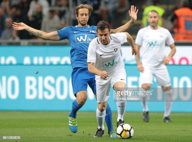 Alessandro Del Piero is challenged by Massimo Ambrosini during Andrea Pirlo Farewell Match at Stadio Giuseppe Meazza on May 21 2018 in Milan Italy