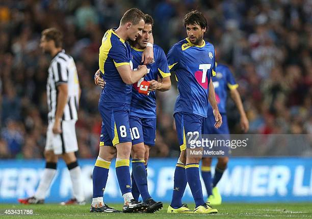 Alessandro Del Piero is embraced by Besart Berisha of the All Stars after being substituted in the second half during the match between the ALeague...