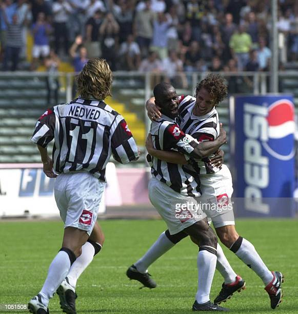 26 AUG 2001 Alessandro DEL PIERO Liliam THURAM and Pavel NEDVED of Juventus celebrating Alex's goal during the SERIE A 1st round game between...