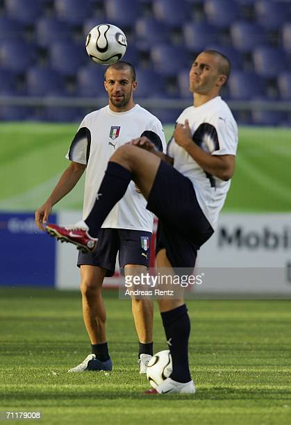 Alessandro Del Piero looks on as Fabio Cannavaro streches during the Italy training session at the FIFA World Cup Stadium Hanover on June 11, 2006 in...