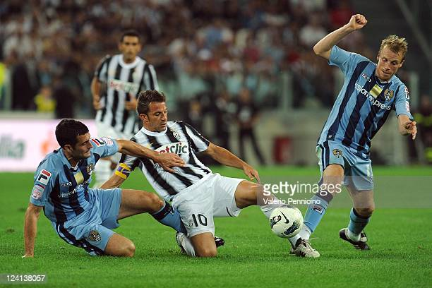 Alessandro Del Piero of FC Juventus is challenged by Mike Edwards and Ricky Ravenhill of Notts County during the exhibition match between FC Juventus...