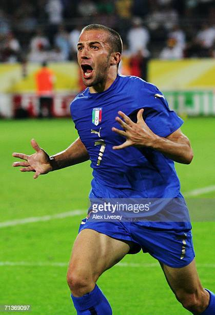 Alessandro Del Piero of Italy celebrates scoring his team's second goal in extra time during the FIFA World Cup Germany 2006 Semifinal match between...