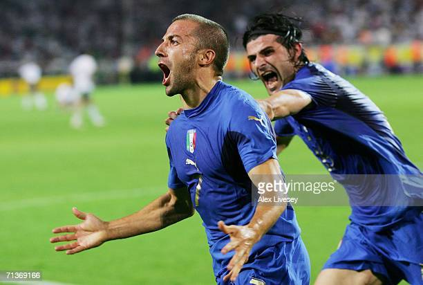 Alessandro Del Piero of Italy celebrates scoring his team's second goal in extra time with team mate Vincenzo Iaquinta during the FIFA World Cup...