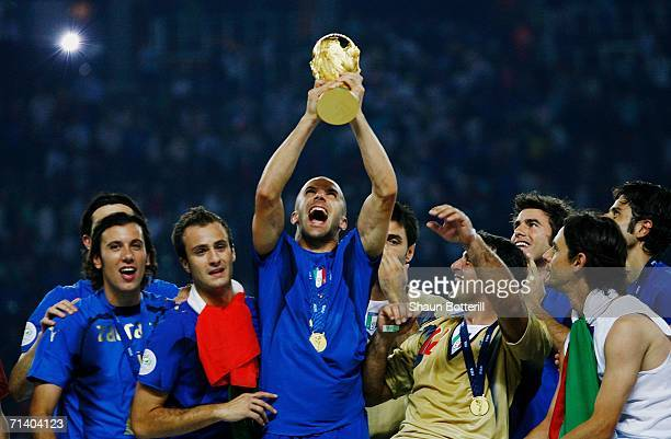 Alessandro Del Piero of Italy holds the World Cup trophy aloft following his team's victory in a penalty shootout at the end of the FIFA World Cup...