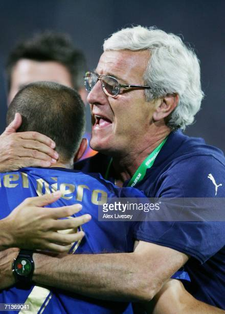Alessandro Del Piero of Italy is embraced by Manager Marcello Lippi after scoring his team's second goal in extra time during the FIFA World Cup...