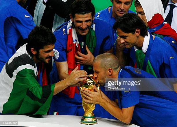 Alessandro Del Piero of Italy kisses the World Cup trophy following his team's victory in a penalty shootout at the end of the FIFA World Cup Germany...