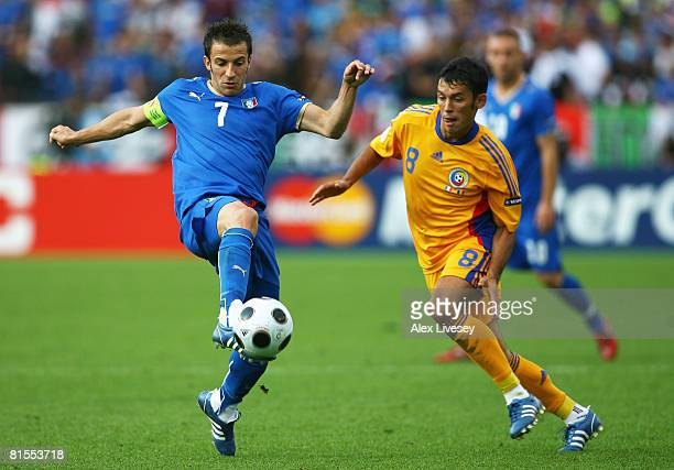 Alessandro Del Piero of Italy passes the ball in front of Paul Codrea of Romania during the UEFA EURO 2008 Group C match between Italy and Romania at...