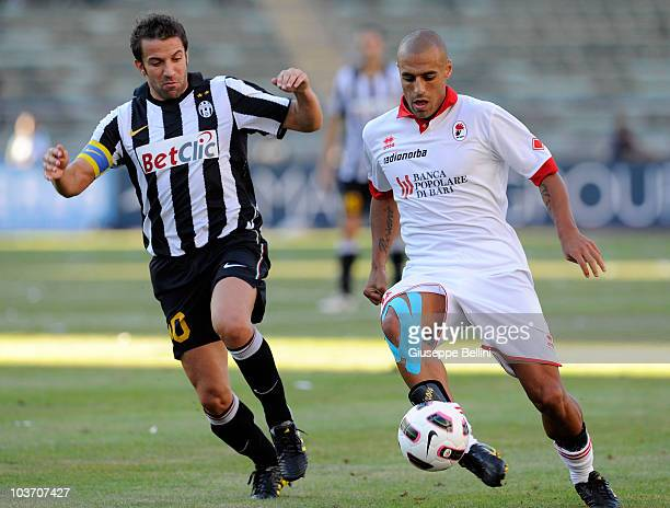 Alessandro Del Piero of Juventus and Sergio Almiron of Bari in action during the Serie A match between Bari and Juventus at Stadio San Nicola on...
