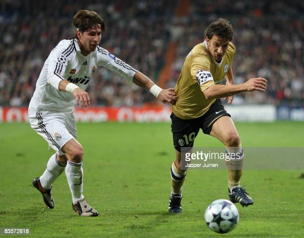 Alessandro Del Piero of Juventus duels for the ball with Sergio Ramos of Real Madrid during the UEFA Champions League Group H match between Real...