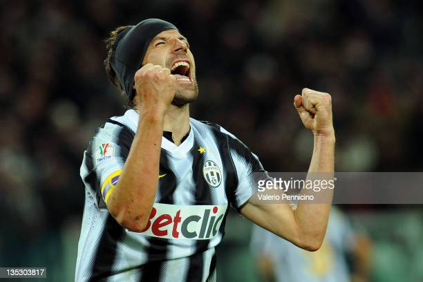Alessandro Del Piero of Juventus FC celebrates the gol of his teammates Emanuele Giaccherini during the Tim Cup match between Juventus FC and Bologna...