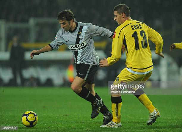 Alessandro Del Piero of Juventus FC competes for the ball with Andrea Coda of Udinese Calcio during the Serie A match between Juventus and Udinese at...