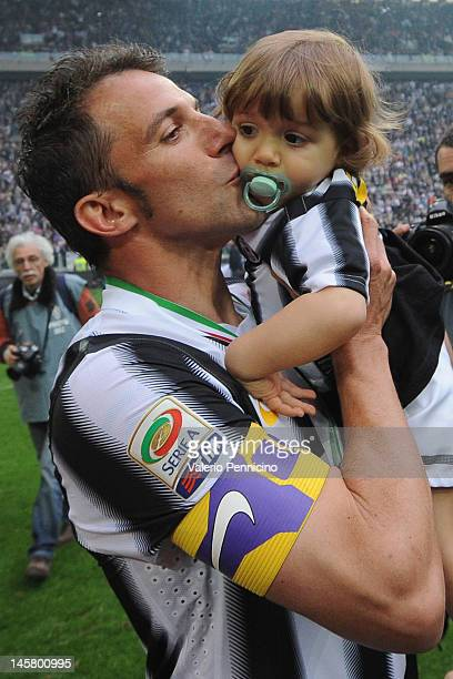 Alessandro Del Piero of Juventus FC kiss his child after the Serie A match between Juventus FC and Atalanta BC at Juventus Stadium on May 13 2012 in...