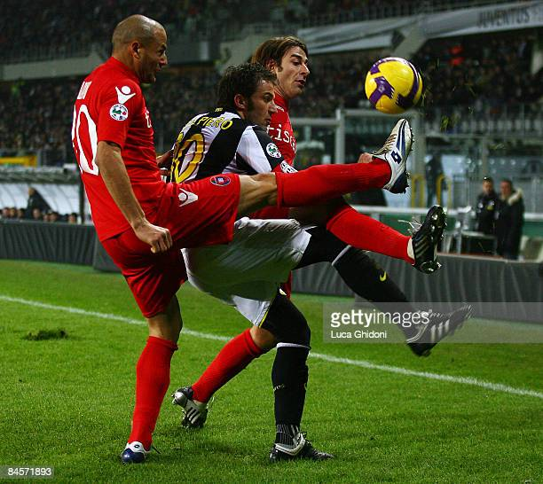 Alessandro Del Piero of Juventus fights for the ball with Paolo Bianco and Daniele Conti of Cagliari during the Serie A football match between FC...