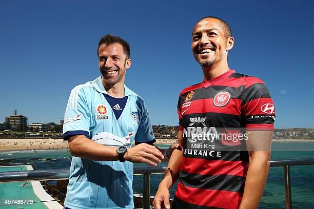 Alessandro Del Piero of Sydney FC and Shinji Ono of the Western Sydney Wanderers laugh as they pose for photographs during the launch of the...