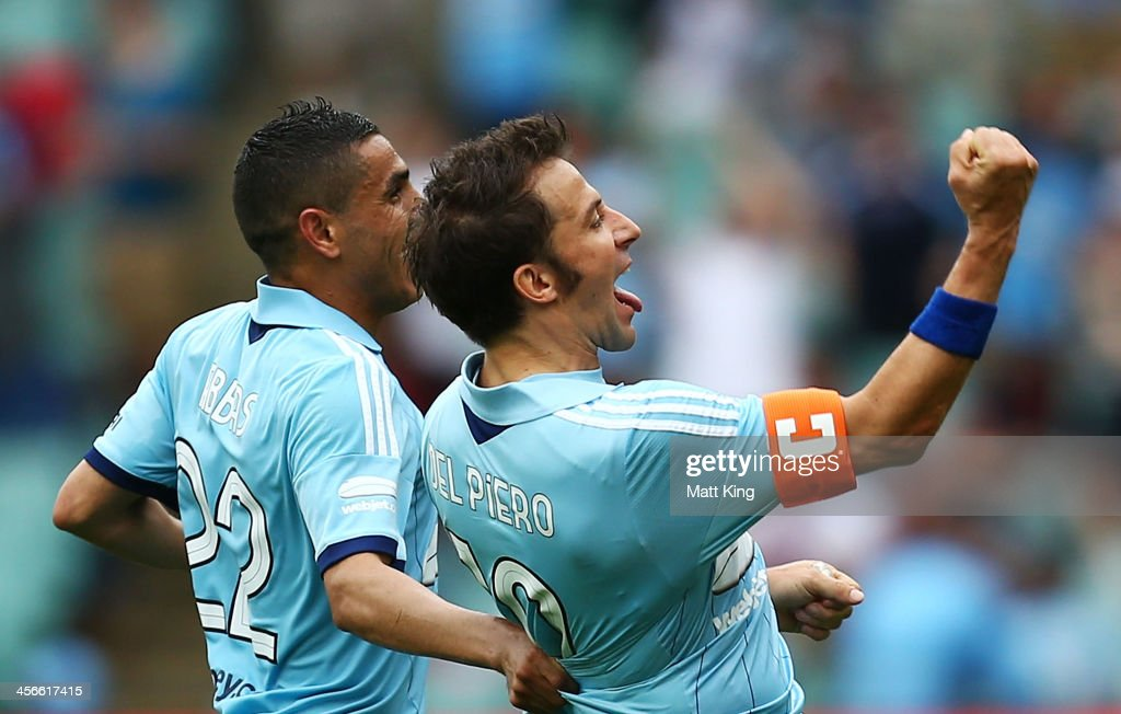 Alessandro Del Piero (R) of Sydney FC celebrates with Ali Abbas (L) after scoring the first goal during the round 10 A-League match between Sydney FC and the Melbourne Heart at Allianz Stadium on December 15, 2013 in Sydney, Australia.