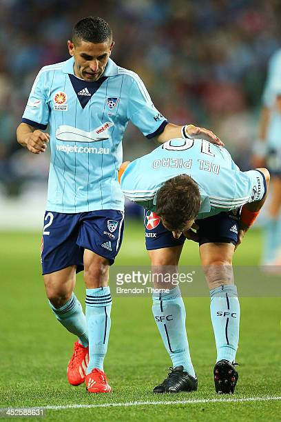 Alessandro Del Piero of Sydney grabs at his hamstring as team mate Ali Abbas comforts him during the round eight ALeague match between Sydney FC and...