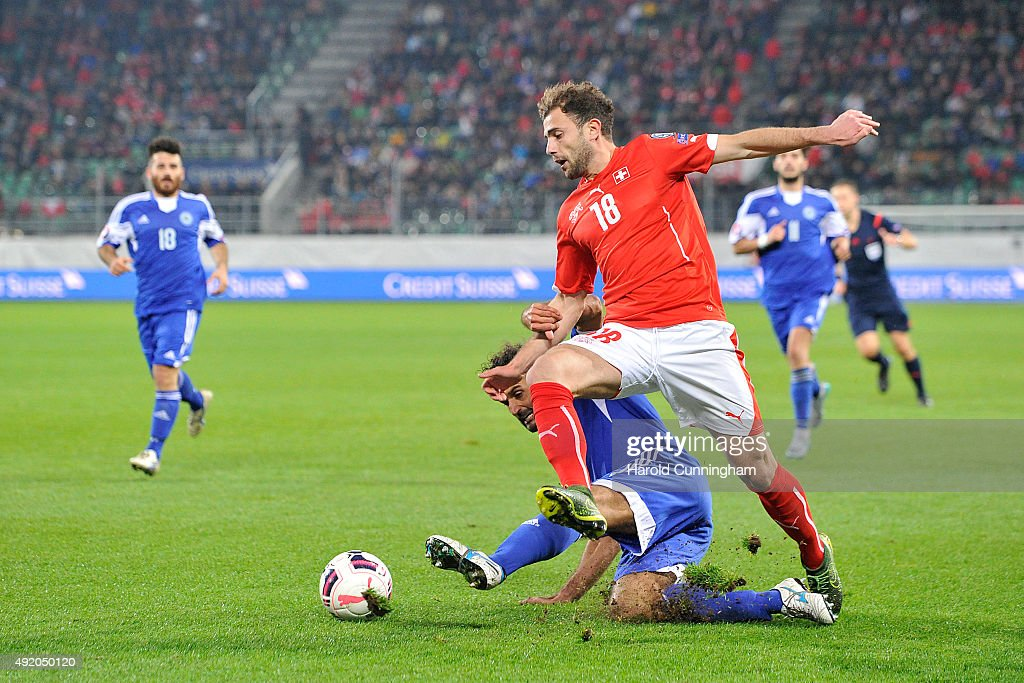 Alessandro Della Valle of San Marino and Timm Klose of Switzerland during the UEFA EURO 2016 qualifier between Switzerland and San Marino at AFG Arena on October 9, 2015 in St Gallen, Switzerland.