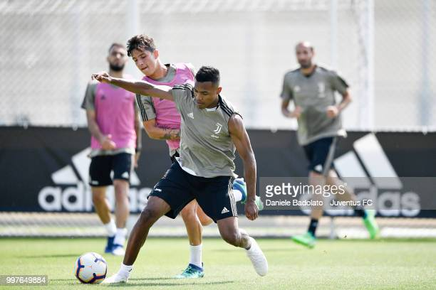 Alessandro Di Pardo and Alex Sandro during a Juventus training session at Juventus Training Center on July 13 2018 in Turin Italy
