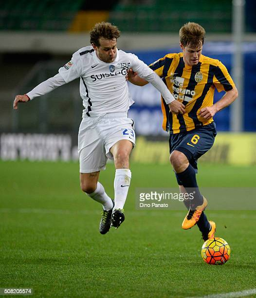 Alessandro Diamanti of Atalanta BC competes with Michelangelo Albertazzi of Hellas Verona during the Serie A match between Hellas Verona FC and...