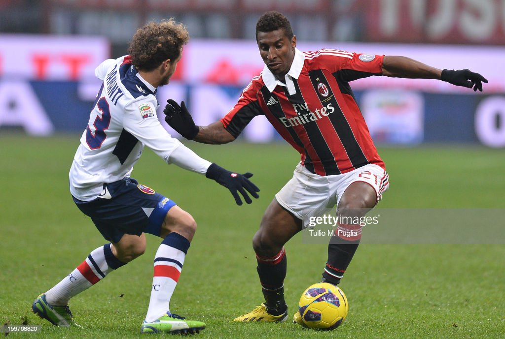 Alessandro Diamanti (L) of Bologna and Kevin Constant of Milan compete for the ball during the Serie A match between AC Milan and Bologna FC at San Siro Stadium on January 20, 2013 in Milan, Italy.