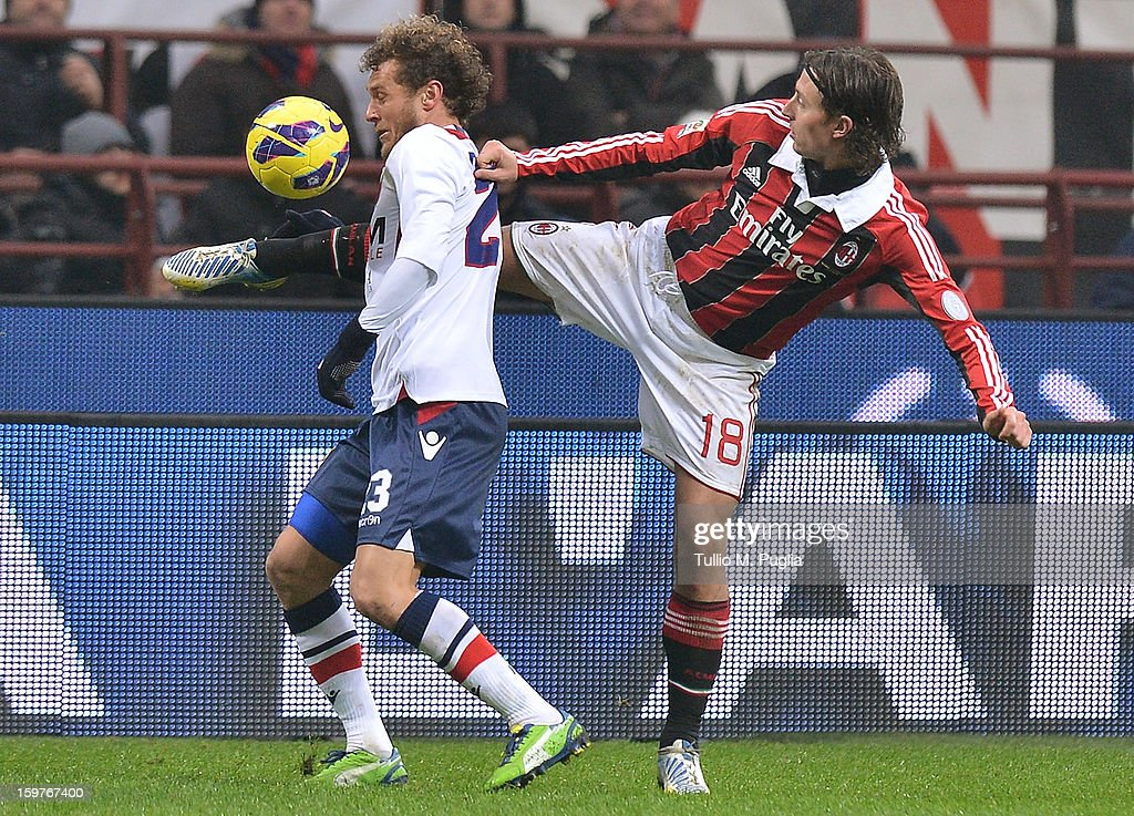 Alessandro Diamanti (L) of Bologna and Riccardo Montolivo of Milan compete for the ball during the Serie A match between AC Milan and Bologna FC at San Siro Stadium on January 20, 2013 in Milan, Italy.